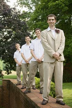Make the groom stand out by putting him in a full suit. keep his men low key in matching trousers and no jacket.