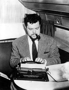 Orson back in the good old days when men wore suits to fly and typewriters were allowed on airplanes. Today you can only carry small knives, because, as we all know, the typewriter is mightier than the sword.    Orson Welles