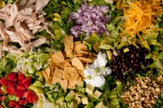 This chicken taco salad recipe full of chicken breast meat, black beans, cheese, and avocado gets tossed in a tangy Tex-Mex dressing.