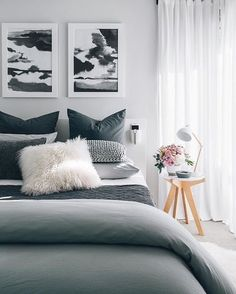 3 framed pictures above bed with wall colored background and frame