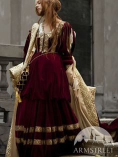 This dress is extraordinary and beautiful combination of eleven yards of velvet, nine yards of cotton lining and more then twenty yards of trimming.