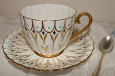Royal Chelsea:  Beautiful tea cup and saucer with gold gilding