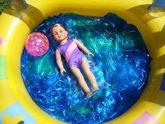 Using an inner tube and filling it with blue Saran wrap. Then add beach/ pool toys and use as a mini swimming pool for AG Dolls, Our Generation Dolls, or really any dolls in general. Ag Doll Crafts, Diy And Crafts Sewing, Crafts For Girls, Diy For Girls, Diy Doll, Fun Crafts, American Girl Parties, American Girl Crafts, American Girl Accessories