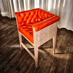 This tomato Leather tufted seat and back gives this a traditional, kind of regal feel but fresh and modern at the same time...I'm in love with this