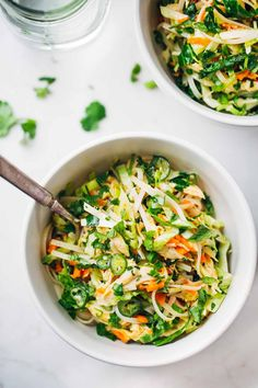 Vietnamese Chicken Salad with Rice Noodles - Made with chicken, cabbage, carrots, homemade dressing, lime juice, mint, and cilantro.