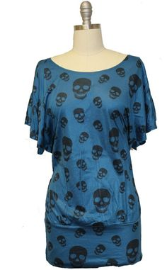 Teal and skull sublimation print top with wide banded hem  94%Rayon 6%Spandex   Made in USA