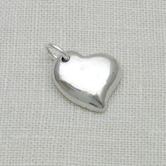 Sterling Silver Asymmetrical Heart with Your Cremation Ashes. This handmade charm by A Timeless Impression is a beautiful way to keep your loved one or your beloved pet close to your heart. Dog Jewelry, Custom Jewelry, Fingerprint Jewelry, Equestrian Jewelry, Cremation Ashes, Unique Gifts For Men, Memorial Jewelry, Antique Jewelry, Silver Jewelry