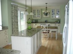 simple kitchen -- uncluttered.  dining area included in design making area looking much larger.