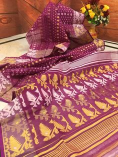 Dark Raspberry color tant Dhakai Jamdani saree is ready to make you fall for it. All over the body Golden Yellow and White floral weaving will keep every eye on Dhakai Jamdani Saree, Handloom Saree, Bengali Saree, Raspberry Color, Indian Attire, Golden Yellow, Floral Rug, Online Gifts, Exclusive Collection