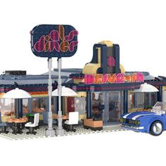 Hello! I know what you might be thinking. This old diner looks oddly symmetrical. Surprisingly, the interior is not! This modern take on an old diner introduces a custom arcade area to play and have fun in after dining with family. This set features: Leather Seats Milkshake Bar Jukebox Dancing Game Claw Machine Classic Arcade Machines Air Hockey Old Sports Car Outside Table Area 2 Waitress Minifigs 2 Customers And much more! Please note minifigs are for display purposes only. The actual set…