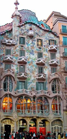 Casa Batllo is a renowned building located in the center of Barcelona, Spain and is one of Antoni Gaudi's masterpieces. It was redesigned in 1904 by Gaudi and has been refurbished server times. Much of the facade is decorated with a mosaic made of broken ceramic tiles that starts in shades of golden orange moving into greenish blues. Photo: google+