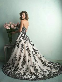 Wow! 0.o Don't know about a wedding dress because of the black, but it's gorgeous.