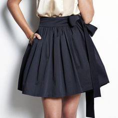 black pleated skirt with bow
