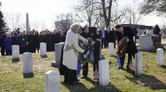 """NASA Day of Remembrance Martha Chaffee widow of Roger Chaffee Sheryl Chaffee daughter and Roger Purvenas son of Sheryl Chaffee left along with acting NASA Administrator Robert Lightfoot right place wreaths at the graves of Apollo 1 crewmembers Virgil """"Gus"""" Grissom and Roger Chaffee as part of NASA's Day of Remembrance Tuesday Jan. 31 2017. January 31 2017"""