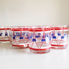 Excited to share this item from my #etsy shop: VINTAGE | set of 12 red, white & blue lowball bar glasses #housewares #red #blue #glass #redwhiteblue #fourthofjuly #patriotic #americanholiday #rocksglass