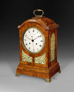 """A fine and rare George III Period Mahogany Cased Bracket Clock signed on the enamelled dial """"Alexr. Cumming London No. 411"""",the twin fusee deadbeat escapement striking the hours on one bell with a pull-repeat to the right hand side, the profusely chased and engraved back plate also signed Alexr. Cumming London. Note: As well as the normal hour and minute hand, this movement has a sweep seconds hand.  Ca.1790"""