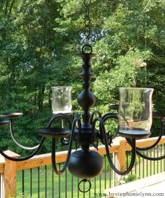 Repurposed Brass Lighting Fixture Turned Outdoor Candle Chandelier Old Brass Fixture Painted Black And Added Candles What A Great Idea For Outside Entertaining Solar Light Chandelier, Chandelier Planter, Outdoor Chandelier, Chandeliers, Diy Chandelier, Solar Lights, Backyard Lighting, Porch Lighting, Outdoor Lighting