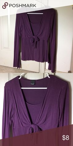 Purple long sleeved blouse Pretty purple long sleeved blouse that ties up over a tank top that's connected underneath. There is a tiny little hole by the tag that can easily be sown together and it doesn't have a size on it but runs like a medium! Tops Blouses