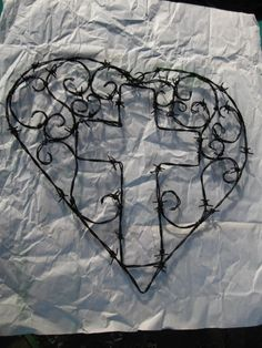 Barbed wire heart with cross in the center