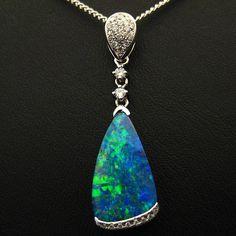 Boulder Opal and diamonds in White Gold. So elegant and simple. #lightningridgeopalmines #opal #Melbourne