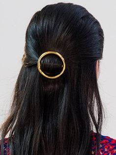 half-up loop with a barrette - Celine | allure.com