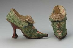 Pair of women's buckle shoes, European, 1700-30s. Silk satin brocade with applied metalic and silk bobbin lace, silk ribbon, and leather.