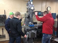 LHS students machining a key part for the 2013 bot.