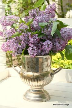 Nothing prettier than lilacs in a silver ice bucket.