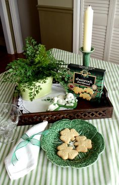 Beautiful vignette for St. Patrick's Day...live plant, candle, lace, celtic knot-like tray, shamrock shaped shortbread cookies & little lambs.  So Sweet!