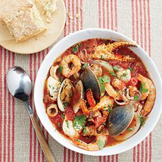 Cioppino is San Francisco's signature dish, but seafood lovers everywhere will keep this recipe close to their hearts.Heat oil in a large soup pot over medium heat. Add onion and garlic, and cook 7 … Best Shrimp Recipes, Seafood Recipes, Cooking Recipes, Healthy Recipes, Cooking Tips, Healthy Cooking, Fish Recipes, Yummy Recipes, Dessert Recipes
