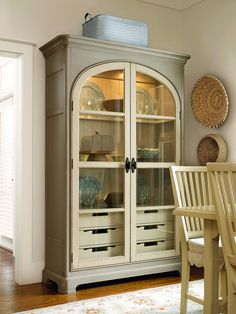 River House Collection- Paula's Best Dishes Pantry with canister lighting, wood framed glass shelves, and six tray drawers in an Oyster Shell finish