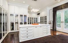 Giant, white walk-in closet perfectly organized
