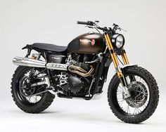 Tridays Triumph Scrambler  Right out of the wrapper, Triumph's Scrambler model is pretty sick. It's packed with a classic-looking 865cc Paralles twin motor and a trim package made for on or off-road action. The beefed-up, modified custom you see here was built by two skillful European craftsmen for Germany's annual summer Triumph festival called Tridays, and its classic grass-track race called the Rumble. Looks like a winner to us.