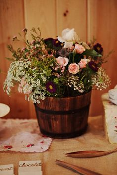 flowers in a whiskey barrel planter @Kelsey Myers Anderson