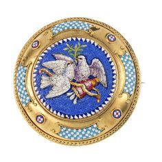 A micro-mosaic brooch. The circular panel depicting two doves, within a geometric mosaic and cannetille surround.
