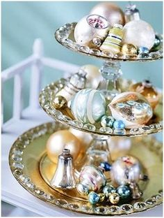 tiers--looks like clear glass candle holders with glass plates and glass pebbles you can buy from 99 cent store glued on them