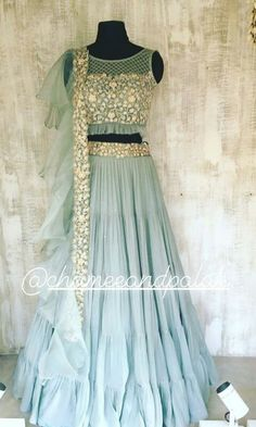 Add a spot of colour to your room with a bright and fresh aqua Indian Fashion Dresses, Indian Gowns Dresses, Dress Indian Style, Indian Designer Outfits, Half Saree Lehenga, Lehnga Dress, Indian Wedding Wear, Indian Bridal Outfits, Party Wear Lehenga