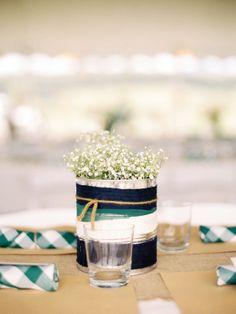 yarn-wrapped paint can centerpieces, photo by Sarah Der Photography http://ruffledblog.com/rustic-virginia-wedding #weddingideas #decor #reception