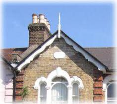 Scalloped white facia board Charcoal House, Gable Trim, Fascia Board, Victorian Porch, House Trim, Cottage Renovation, Glass House, Facade, Backyard