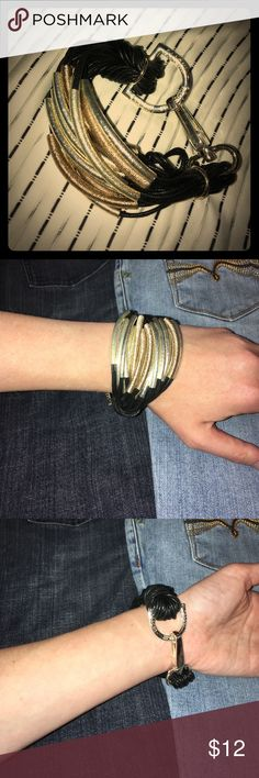 Saachi bracelet Silver with gold and black leather bracelet. Never worn except for picture to sell. saachi Jewelry Bracelets