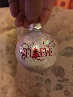 Learn how to create easy and fun Christmas décor ideas for apartments – clear ball ornaments! You can pick most of the supplies you need at your local dollar st Vinyl Ornaments, Glitter Ornaments, Handmade Ornaments, Diy Christmas Ornaments, Homemade Christmas, Simple Christmas, Christmas Projects, Christmas Crafts, Christmas Decorations
