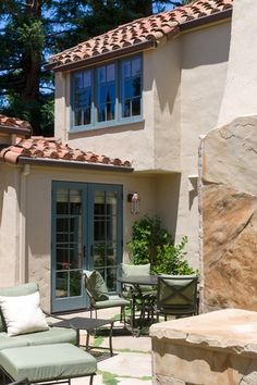 Mediterranean Patio with French doors, exterior stone floors