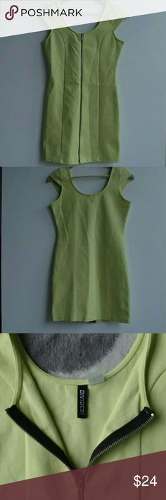 """Divided by H&M Dress, Neon Green, Zip Front - Sz 8 Divided by H&M dress, neon Green/yellow with a zip closure in the front and cap sleeves.  Size 8. Dress is fitted and made from 72% cotton, 24% polyamide, 4% elastane. Perfect dress for your upcoming vacation to the beach! Lay flat measurements: Chest: 31"""" Length:29.75"""" Shoulders: 11.5"""" Waist:26' Please reach out if you have any additional questions! :) Divided Dresses Mini"""