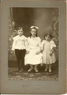 Three little kids...don't know who they are