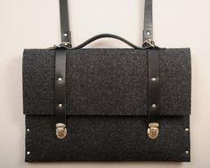 Macbook briefcase 13 MacBook Pro or Air case black synthetic felt briefcase with black leather straps, handle and shoulder strap. $75.00, via Etsy.