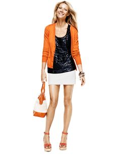 I love everything about this look. If I had those legs I'd slip into that short skirt and walk out the door in this whole combo. For those of us w/ shorter and less slim gams, this look would work with a pencil skirt in a similar color, or a long short in a great fabric. Take this from day to night by replacing the bag with a clutch and slipping off the sweater. I'd also add a long gold necklace.