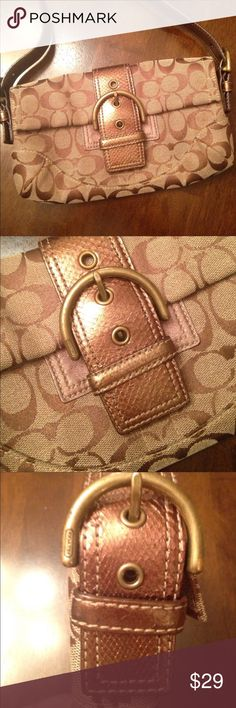 COACH PURSE Cute with copper color handle and bucked on front. In excellent Condition. 10 in from side to side and 7 in top to bottom Bags Shoulder Bags