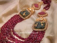 Flamboyant designer multi string ruby necklace for the stylish woman out there. This ruby glass beads mala or long chain with c. Gold Jewellery Design, Bead Jewellery, Latest Jewellery, Beaded Jewelry, Antique Jewellery, Ruby Jewelry, India Jewelry, Ruby Necklace, Necklace Set