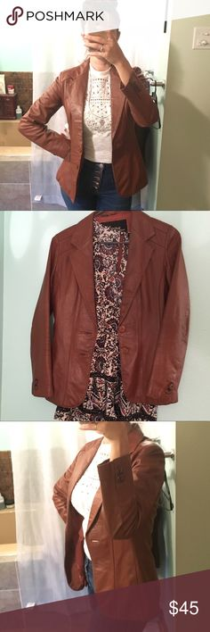 Super cute vintage Wilsons leather jacket! This vintage leather jacket is so cute because it's tailored to fit a women's figure. That perfect sienna brown color goes with all of your vintage inspired wardrobe as well as your new stuff! The lining is in really good shape too, with only one minor discoloration and a little tear by the tag! Tag says size 10, but it's definitely more of a medium. Wilsons Leather Jackets & Coats