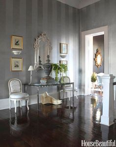 """A Shimmery Entrance -  Designer Ned Marshall painted the walls in silver radiator paint, then added overscaled """"tarnished"""" stripes in gray-tinted glaze - Decorating Foyers with Furniture and Color - House Beautiful"""